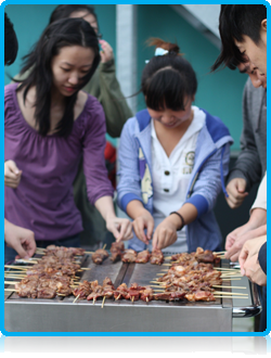 Chinese students at Wittenborg University cooking lamb kebabs August 2012