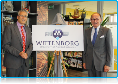 Mr. Fred de Graaf, President of the Senate of the Netherlands' Dutch Parliament reveals Wittenborg University's 25th Anniversary logo