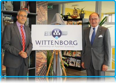 Mr. Fred de Graaf, President of the Senate of the Netherlands' Dutch Parliament reveals Wittenborg University's 25th Anniversary logo