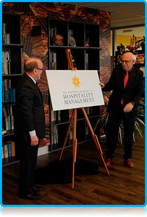 New Hotel School Programme in Apeldoorn! - Alderman Johan Kruithof launches the European Academy of Hospitality Management's new logo at Wittenborg University's campus.