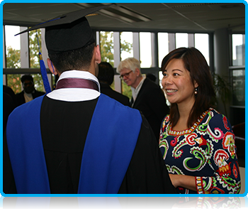 Wittenborg University Director Maggie Feng talking with students at Graduation