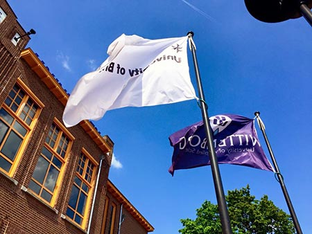 Wittenborg and University of Brighton Flags fly at the Spoortstraat Building, Apeldoorn Campus